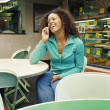 Stock Photo: Young woman talking on mobile phone
