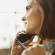 Close up of young woman talking on phone — Stock Photo