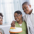 African American mother and children with birthday cake - Foto de Stock