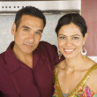 Portrait of Hispanic couple hugging in kitchen — Stock Photo