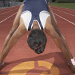 Female track athlete stretching — Lizenzfreies Foto