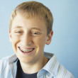 Teenaged boy smiling with braces — Stock Photo #13228654