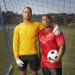 Portrait of two soccer players with ball — Stock Photo #13228691