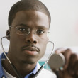 Stock Photo: African male doctor with stethoscope