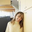 Businesswoman laughing in office space - Stock Photo