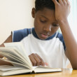 African American boy reading book — Stock Photo
