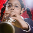 Hispanic girl playing clarinet — Stock Photo #13228722