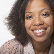 Stock Photo: Close up portrait of woman smiling
