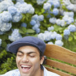 Young man relaxing in a lawn chair — Stock Photo