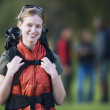 Stock Photo: Young backpacker smiling for cameroutdoors