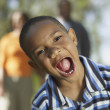 Stock Photo: Young African boy with mouth wide open