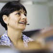 Businesswoman wearing headset — Foto Stock