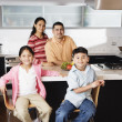 Portrait of family in domestic kitchen - Stock Photo