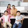 Portrait of family in domestic kitchen — Stock Photo