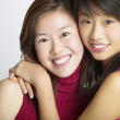 Stock Photo: Portrait of sisters hugging