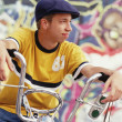 Teenage boy sitting on his bike — Stock Photo