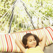Hispanic girl in hammock — Stock Photo