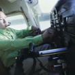 Stock Photo: Madjusting controls in airplane