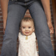 Royalty-Free Stock Photo: Baby standing between mother\'s legs