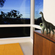 Toy dinosaurs on cabinet - Stock Photo