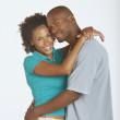 Young couple hugging and smiling for the camera — Stock Photo #13229013