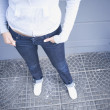 High angle view of woman with hands in pockets - Stock Photo