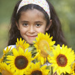 Portrait of girl and sunflowers - Stock Photo