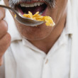 Close up of middle-aged man eating  — Stock Photo