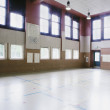 Foto Stock: Interiors of empty basketball court