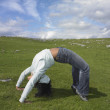 Stock Photo: Womdoing back bend