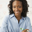 Portrait of African businesswoman holding marker  — Stock Photo