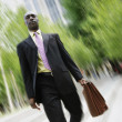 Businessman descending steps — Stock Photo