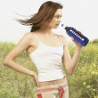 Stock Photo: Womdrinking bottled water