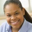 Close up of African American woman smiling — Stock Photo #13229297