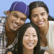 Close up portrait of three teenagers smiling — Stock Photo