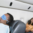 Passengers on airplane — Foto Stock