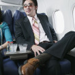 Portrait of an adult couple traveling in an airplane — Stock Photo