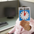 Businessman holding up will return sign — Stockfoto