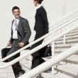 Stock Photo: Hispanic businesspeople walking down stairs