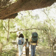 Hispanic family hiking with backpacks — Stock Photo