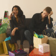 Couple surrounded by presents — Stock Photo #13229525