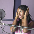 Stock Photo: AfricAmericwomsinging in recording studio