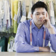 Bored Asian dry cleaner  — Stock Photo