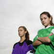 Portrait of two girls in soccer uniforms - Stockfoto