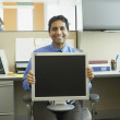 Stock Photo: Businessmwith computer monitor on lap