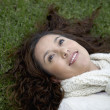 Hispanic woman laying in grass — Stock Photo