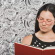 Stock Photo: Young woman reading book
