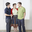 Hispanic mother and adult sons hugging - Stock Photo