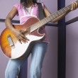 African American woman playing guitar - Stock Photo
