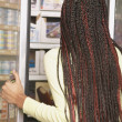 Woman looking in freezer section at supermarket - Stock Photo